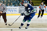 KELOWNA, CANADA, JANUARY 27: Brendan Rouse #16 of the Seattle Thunderbirds skates with the puck as the Seattle Thunderbirds visit the Kelowna Rockets on January 27, 2012 at Prospera Place in Kelowna, British Columbia, Canada (Photo by Marissa Baecker) *** Local Caption ***