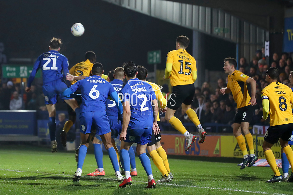 AFC Wimbledon defender Luke O'Neill (2) and AFC Wimbledon defender Terell Thomas (6)watch AFC Wimbledon defender Ryan Delaney (21) winning a header in the box during the EFL Sky Bet League 1 match between AFC Wimbledon and Southend United at the Cherry Red Records Stadium, Kingston, England on 1 January 2020.