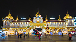 Illuminated Thailand Pavilion at night at Global Village 2015 in Dubai United Arab Emirates