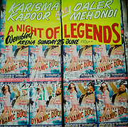 A wall covered with posters advertising Karisma Kapoor and Daler Mehndi 'The dynamic duo' Sunday 25th June at Wembley Arena
