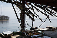 The bay area of Matsukawaura, seen through the remnants of a shoreline building, bent, buckled and ripped apart by the 2011 tsunami, in Soma, Japan, on Monday 23 July 2012.