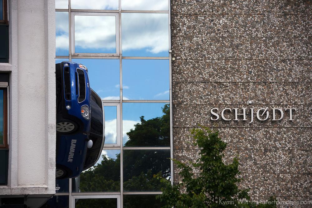 Europe, Norway, Stavanger. Automobile on side of building in Stavanger, Norway.