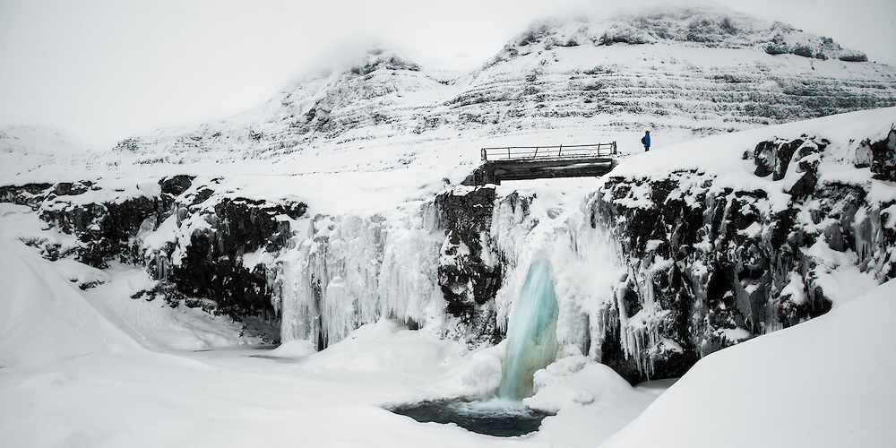 Its hard to get a sense of size unless we can relate to a known object. The inclusion of a fellow photographer in the this scene provides the necessary element. And as an added bonus wearing a blue jacket to match the freezing cold water pouring from the frozen waterfall.