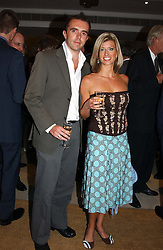 MR ANDY HIPKISS and presenter CAROLINE FARADAY at the Conservative party Pre-Conference Season party hosted by Lord Saatchi and Lord Strathclyde and held at M&C Saatchi, 36 Golden Square, London W1 on 7th September 2004.