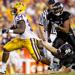 Sep 18, 2010; Baton Rouge, LA, USA;  LSU Tigers running back Stevan Ridley (34) breaks away from Mississippi State Bulldogs linebacker Chris White (50)during the first half at Tiger Stadium.  Mandatory Credit: Derick E. Hingle