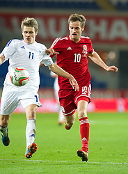CARDIFF, WALES - Saturday, November 16, 2013: Wales' Andy King in action against Finland's Riku Riski during the International Friendly match at the Cardiff City Stadium. (Pic by David Rawcliffe/Propaganda)