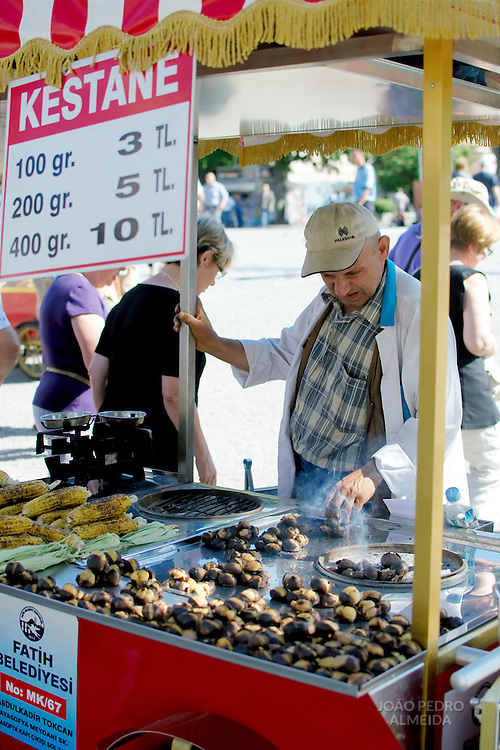 Man selling roasted chetnuts at an Istanbul square