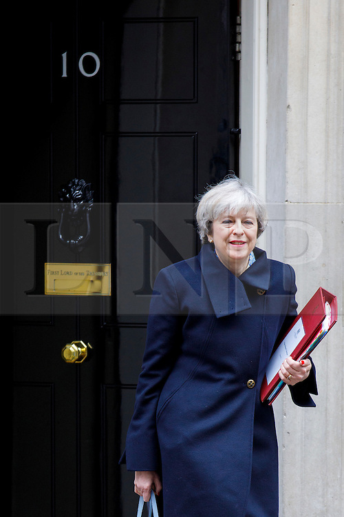 © Licensed to London News Pictures. 01/03/2017. London, UK. Prime Minister THERESA MAY leaves Downing Street to attend Prime Minister's Question Time in House of Commons in London on 1 March 2017. Photo credit: Tolga Akmen/LNP