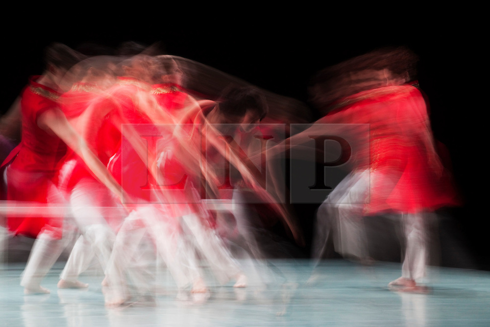 """© Licensed to London News Pictures. 29/02/2012. London, England. London Premiere of The Richard Alston Dance Company's latest work """"A Ceremony of Carols"""" sung and played live on stage to Benjamin Britten's music by the Canterbury Cathedral Choir conducted by David Flood and harpist Camilla Pay. Motion blur effect. Photo credit: Bettina Strenske/LNP"""