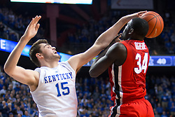 Kentucky forward Isaac Humphries, left, contests a shot by Georgia forward Derek Ogbeide in the first half.<br /> <br /> The University of Kentucky hosted the University of Georgia, Tuesday, Feb. 09, 2016 at Rupp Arena in Lexington .