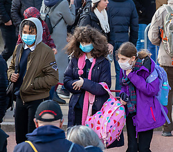 © Licensed to London News Pictures. 11/03/2020. London, UK. Children in masks at Changing of the Guards at Buckingham Palace as Health Minister, Nadine Dorries goes in to self-isolation after catching Covid19. Yesterday British Airways cancelled all flights to and from Italy as fears over the Coronavirus disease continues. Photo credit: Alex Lentati/LNP <br /> <br /> *Permission Not Granted*