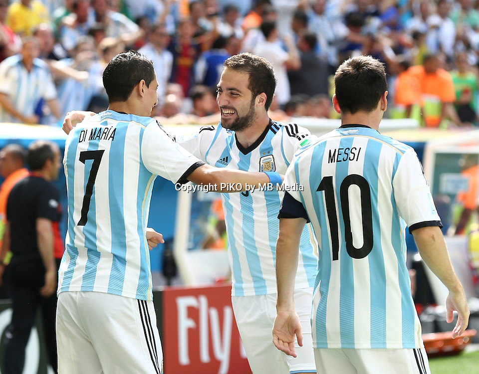 Fifa Soccer World Cup - Brazil 2014 - <br /> ARGENTINA (ARG) Vs. BELGIUM (BEL) - Quarter-finals - Estadio Nacional Brasilia -- Brazil (BRA) - 05 July 2014 <br /> Here Argentine player Angel Di Maria (L), Gonzalo Higuain (C) and Lionel Messii (R)  celebrating Higuain's goal. Scoring the match 1-0.<br /> &copy; PikoPress