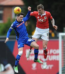 Bristol City's Aden Flint challenges for the header with Rochdale's Ian Henderson - Photo mandatory by-line: Dougie Allward/JMP - Mobile: 07966 386802 - 28/02/2015 - SPORT - football - Bristol - Ashton Gate - Bristol City v Rochdale AFC - Sky Bet League One