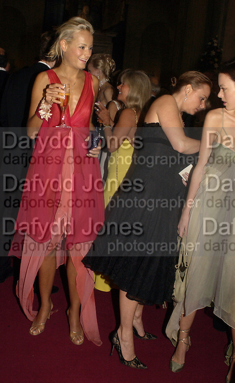 Kalita Al-Swadi, Stella McCartney doing up Melissa Milne, Ball at Blenheim Palace in aid of the Red Cross, Woodstock, 26 June 2004. SUPPLIED FOR ONE-TIME USE ONLY-DO NOT ARCHIVE. © Copyright Photograph by Dafydd Jones 66 Stockwell Park Rd. London SW9 0DA Tel 020 7733 0108 www.dafjones.com