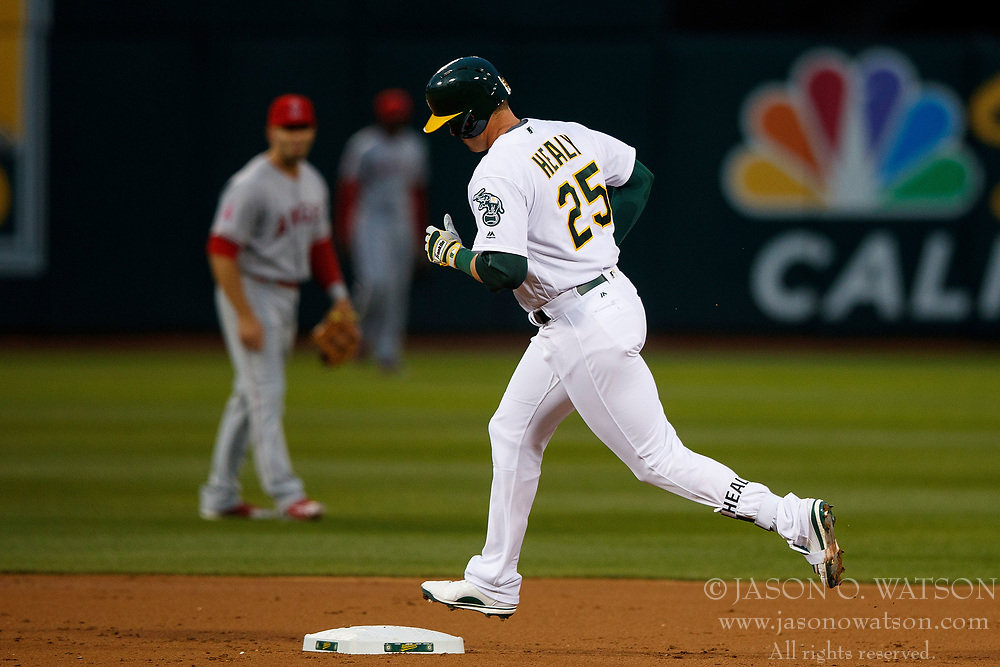 OAKLAND, CA - APRIL 04:  Ryon Healy #25 of the Oakland Athletics rounds the bases after hitting a home run against the Los Angeles Angels of Anaheim during the first inning at the Oakland Coliseum on April 4, 2017 in Oakland, California. The Los Angeles Angels of Anaheim defeated the Oakland Athletics 7-6. (Photo by Jason O. Watson/Getty Images) *** Local Caption *** Ryon Healy