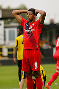 Vadaine Oliver shows his disappointment as he misses during the Friendly match between Harrogate Town and York City at Wetherby Road, Harrogate, United Kingdom on 25 July 2015. Photo by Simon Davies.