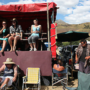 Race goers relax during the 50th Anniversary Glenorchy Race meeting. The races, which originally started in the 1920's, were resurrected in 1962 and have been run by local farmers and the rugby club on the first Saturday after New Years Day ever since. Glenorchy, Otago, New Zealand. 7th January 2012