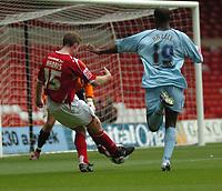 Photo: Ian Hebden.<br />Nottingham Forest v Chesterfield. Coca Cola League 1. 02/09/2006.<br />Forest's Neil Harris (L) shoots on goal.