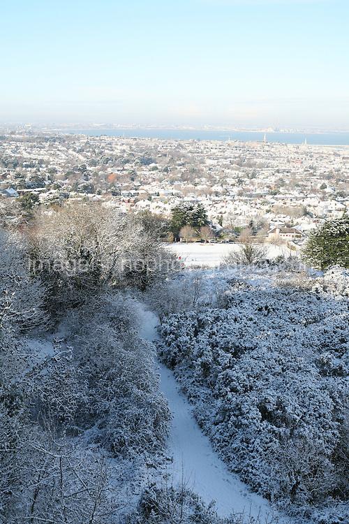 View of Dublin city in the snow from Dalkey Hill Dublin Ireland November 2010