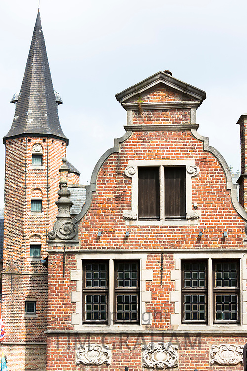 Belgian architecture of brick built building with traditional gable and leaded light windows and turret tower in Bruges, Belgium