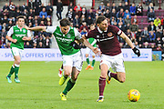 David Milinkovic holds off Lewis Stevenson during the Ladbrokes Scottish Premiership match between Heart of Midlothian and Hibernian at Tynecastle Stadium, Gorgie, Scotland on 9 May 2018. Picture by Kevin Murray.