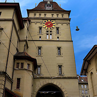Käfigturm Tower East Façade in Bern, Switzerland  <br /> The Käfigturm is one of two fortified towers in the Old City of Bern.  The original was built for protection in 1256 and then replaced in 1643 with this one which is 161 feet tall.  It has served as a watch tower, a prison, a government archive, an information center and today it is a meeting hall for a political group.  However, its primary purpose is to charm the tourists with Medieval flare.