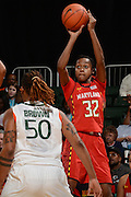 February 13, 2014: Shatori Walker-Kimbrough #32 of Maryland shoots over Maria Brown #50 of Miami during the NCAA basketball game between the Miami Hurricanes and the Maryland Terrapins at the Bank United Center in Coral Gables, FL. The Terrapins defeated the Hurricanes 67-52.