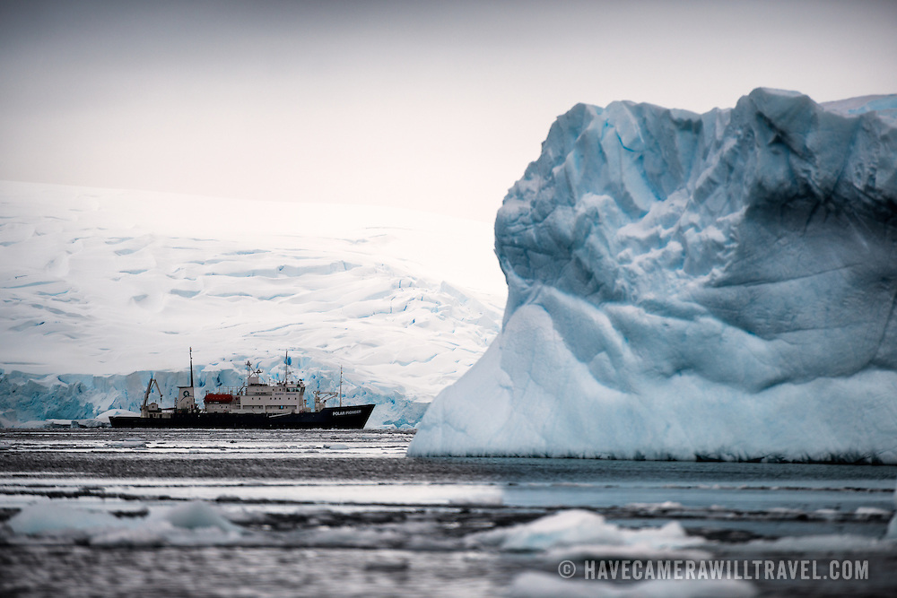 The Polar Pioneer, an Antarctic cruise ship, lies still near the shore in Curtis Bay, Antarctica.