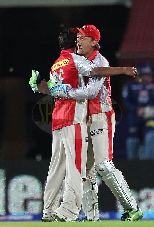 Sandeep Sharma celebrates the wicket of David Warner with Adam Gilchrist during match 67 of the Pepsi Indian Premier League between The Kings XI Punjab and the Delhi Daredevils held at the HPCA Stadium in Dharamsala, Himachal Pradesh, India on the on the 16th May 2013..Photo by Ron Gaunt-IPL-SPORTZPICS ..Use of this image is subject to the terms and conditions as outlined by the BCCI. These terms can be found by following this link:..http://www.sportzpics.co.za/image/I0000SoRagM2cIEc