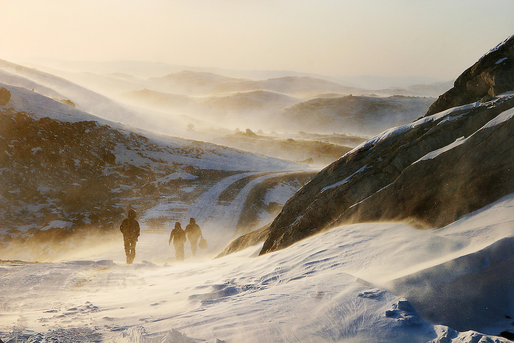 Winds pick up over the frozen tundra of the Russell Glacier near Kangerlussuaq, Greenland.