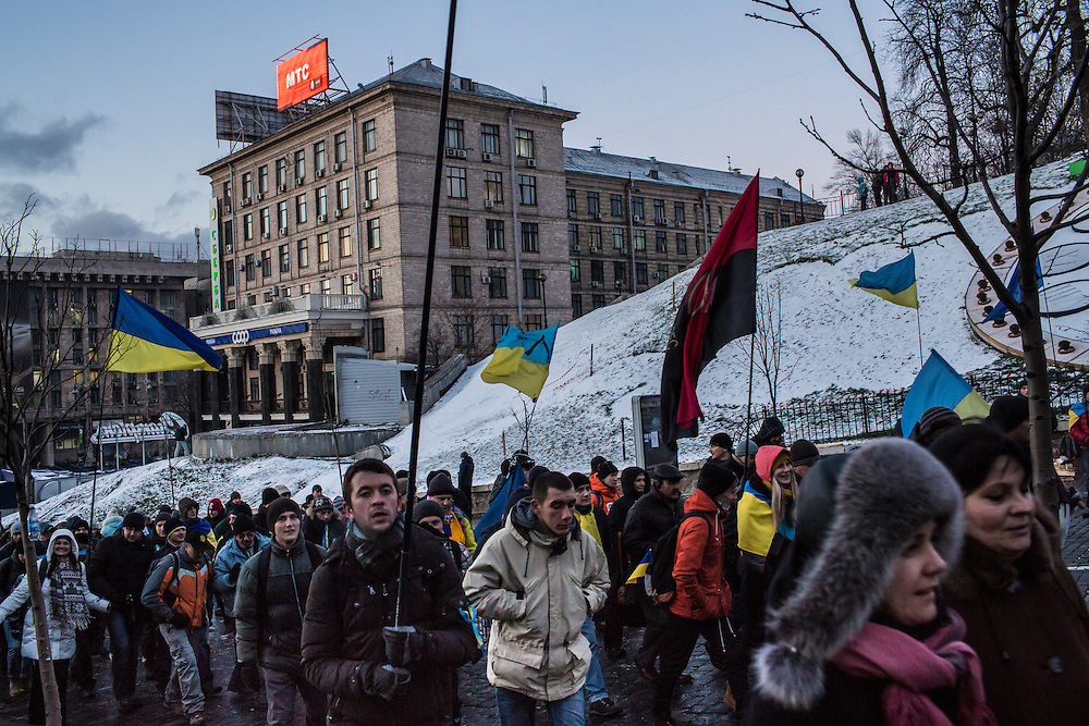 KIEV, UKRAINE - DECEMBER 6: Anti-government protesters march from Independence Square to the prosecutor's office to demand the release of activists arrested for being involved in violent confrontations with police on December 6, 2013 in Kiev, Ukraine. (Photo by Brendan Hoffman/Getty Images)