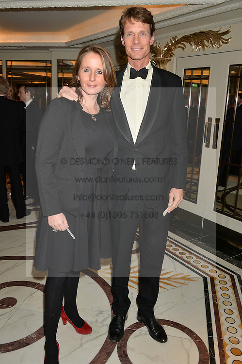 WILLIAM FOX-PITT and his wife ALICE PLUNKETT at the 24th Cartier Racing Awards held at The Dorchester, Park Lane, London on 11th November 2014.