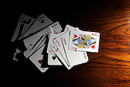 Scattered deck of playing cards on table