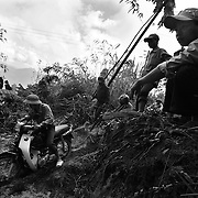 Men take motorbikes through a mudslide in Ha Giang, Vietnam's northernmost province.