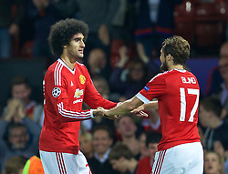 MANCHESTER, ENGLAND - Tuesday, August 18, 2015: Manchester United's Marouane Fellaini celebrates scoring the third goal against Club Brugge during the UEFA Champions League Play-Off Round 1st Leg match at Old Trafford. (Pic by David Rawcliffe/Propaganda)