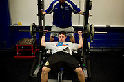 "Georgia State University's Freshman Mark Hogan is the first, and only so far, football recruit to enroll in school history at Georgia State University. He lifts weights with Head Strength and Coordination Coach Ken Coggins at the school in Atlanta, Georgia April 2, 2009. He works out with the coach one-on-one four days a week. He is excited to have teammates, he said. ""It gets pretty lonely sometimes."" KENDRICK BRINSON"