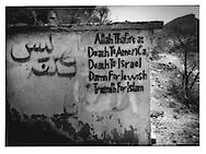 12..Anti-American/ anti-Israel slogan on country road between Manakha and al-Hajjara, Haraz Mountains.