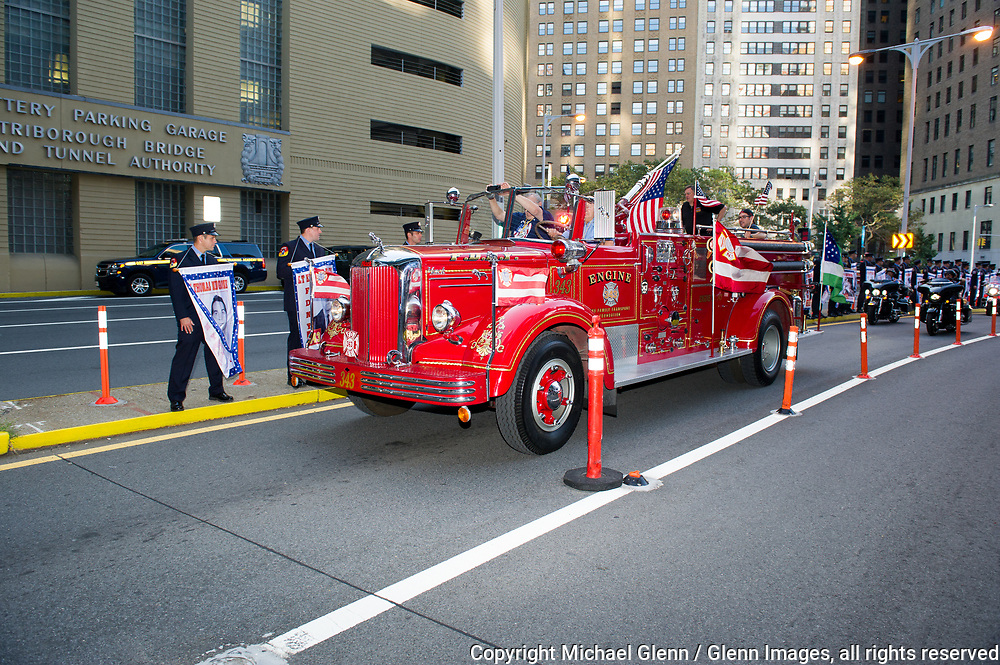 24 Sep 2017 Manhattan, New York United States of America // FDNY Family Transport rig Engine 343 rolls up the route at the Stephen Siller Tunnel to Towers run at the World Trade Center site  Michael Glenn  /