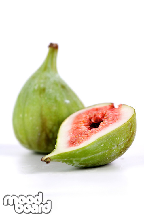 Studio shot of figs on white background