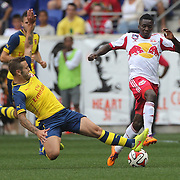 Jack Wilshere, Arsenal, tackles Ambroise Oyongo, New York Red Bulls, during the New York Red Bulls Vs Arsenal FC,  friendly football match for the New York Cup at Red Bull Arena, Harrison, New Jersey. USA. 26h July 2014. Photo Tim Clayton