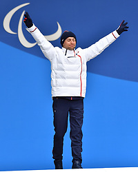 DAVIET Benjamin FRA LW2, ParaSkiDeFond, Para Nordic Skiing, 20km, Podium at  the PyeongChang2018 Winter Paralympic Games, South Korea.