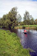 People kayaking River Stour, Dedham Vale, England