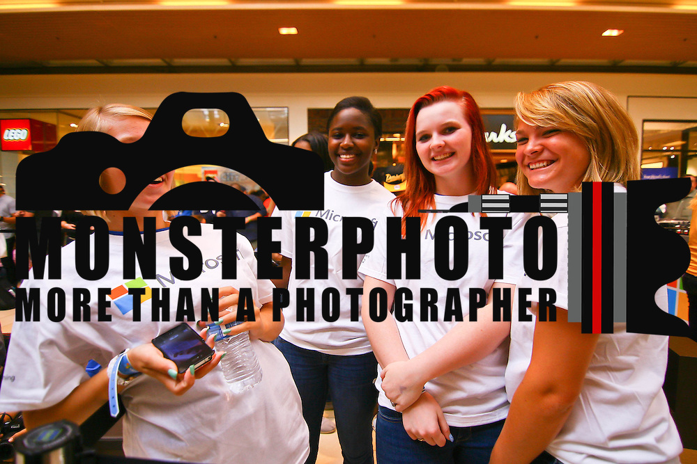 Gabby Gathers, Oneka Taff, Keisey Carrick and Briana Lockard wear Microsoft t-shirts while standing online waiting for the New Microsoft store open Saturday, Sept. 29 2012, at Christiana Mall in Newark DE...