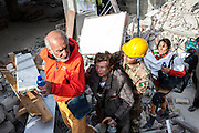 24 August 2016, Amatrice Italy - A Old woman accompanied by rescue team outside the rubble after a 6.3 earthquake hit the town of Amatrice in Lazio region killing more than 240 people. Many other towns of the italian central regions have been hit by the quake. There are still many missing people under the rubble.