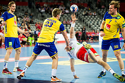 Max Darj of Sweden and Albin Lagergren of Sweden vs Goran Johannessen of Norway during handball match between National teams of Sweden and Norway on Day 7 in Main Round of Men's EHF EURO 2018, on January 24, 2018 in Arena Zagreb, Zagreb, Croatia.  Photo by Vid Ponikvar / Sportida