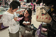 In a tourist store of Shamian island in Guangzhou, Terri offers 9 years old Meylinn a pair of sleepers. Meylinn busy with her video game and with no understanding of English doesn't answer. Terri along with Chad her husband have adopted Meylinn. It's their second adoption and third child. 9 years old is a late age to be adopted and at this age Meylinn had little chance to find a family. At this age, the integration to a new, the mastering of a new language are more arduous than for younger kids.