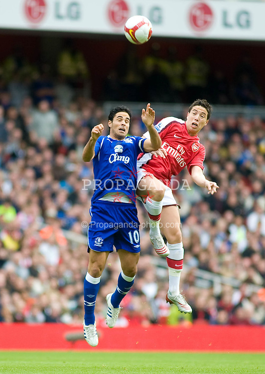 LONDON, ENGLAND - Saturday, October 18, 2008: Everton's Mikel Arteta and Arsenal's Samir Nasri challenge for the ball in the air during the Premiership match at the Emirates Stadium. (Photo by Gareth Davies/Propaganda)