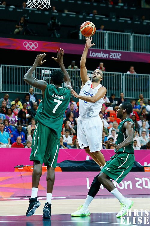 06 August 2012: France Tony Parker goes for the layup over Nigeria Al-Farouq Aminu during 79-73 Team France victory over Team Nigeria, during the men's basketball preliminary, at the Basketball Arena, in London, Great Britain.