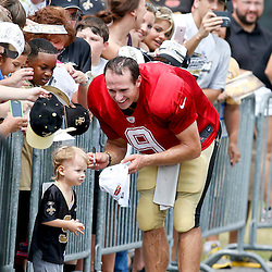 Aug 3, 2013; Metairie, LA, USA; New Orleans Saints quarterback Drew Brees (9) with son Bowen Brees following a scrimmage at the team training facility. Mandatory Credit: Derick E. Hingle-USA TODAY Sports