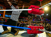 """The referee shows two points to the """"Master of Mayhem"""" Tommy Mack during the main event Street Fight with """"Samoan Storm"""" AFA Jr at the Whiskey Barrel's Pro Wrestling Injustice for Brawl Saturday night. (Karen Bobotas/for the Laconia Daily Sun)"""